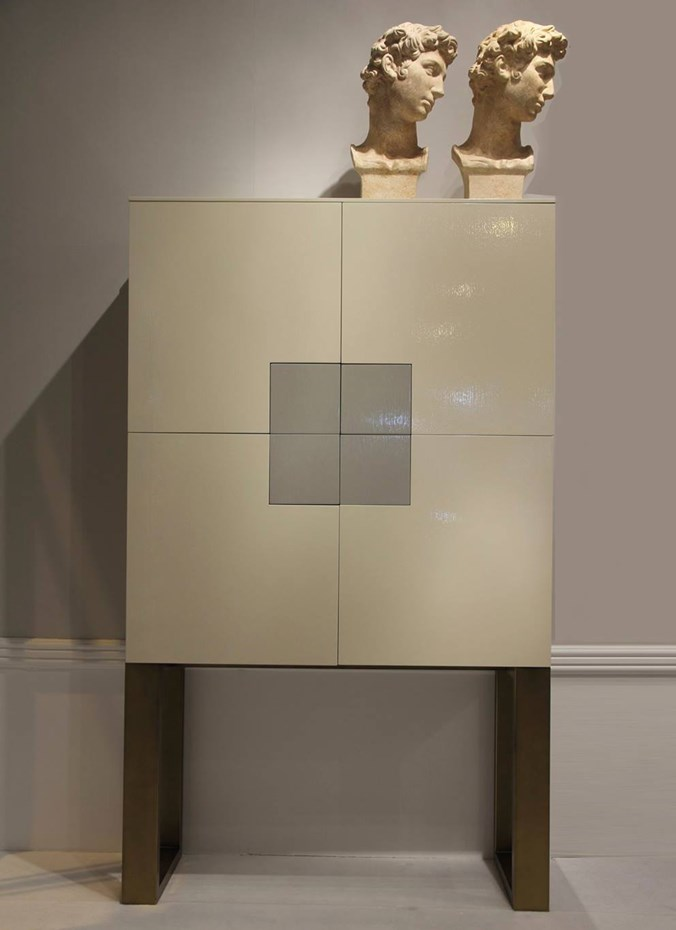 An amazing combination: classic busts & a contemporary cabinet