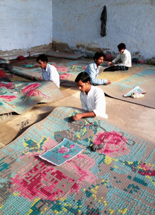 Indian Craft Workers Weaving A Canevas Carpet
